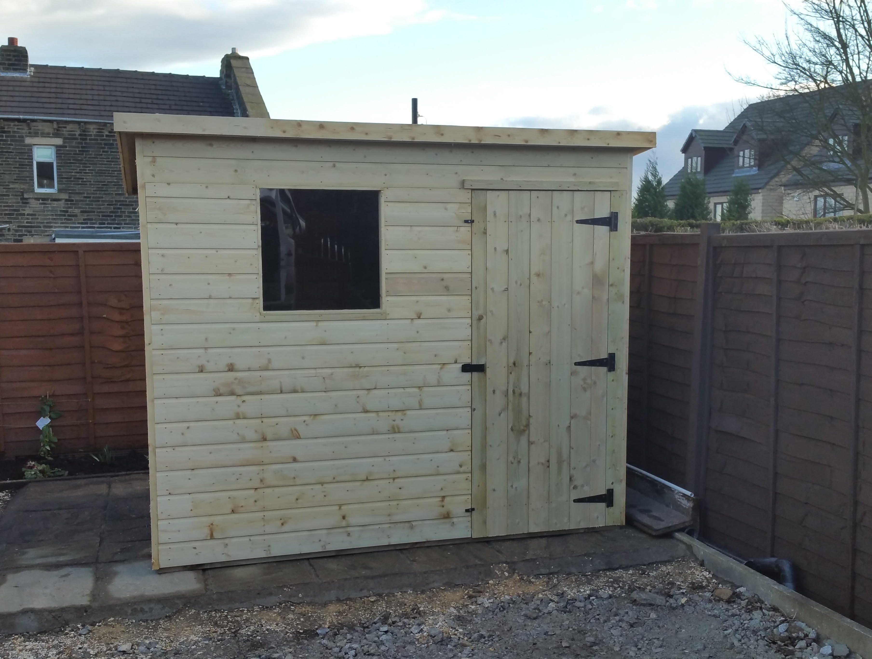 Pent Shed 1 Front Window To The Left and Front Door To the Right